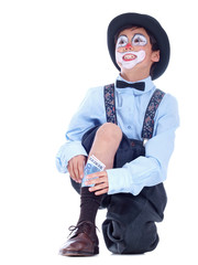 child clown hiding money in his socks