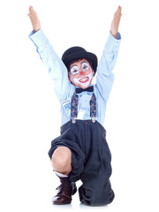 happy child clown with money hidden in his shirt & socks