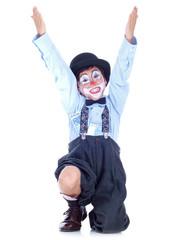 happy child clown with money hidden in his shirt & socks