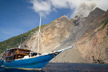 The boat bellow active volcano
