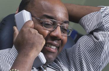 Businessman Pleased On Phone