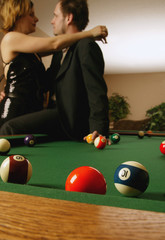 Couple Embraces By Pool Table