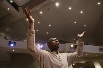 Man Worshipping In Church