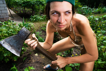 serious woman with an ax