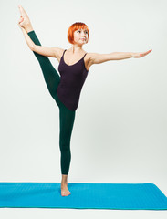 Slim woman practicing yoga asana