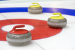 Group of curling rocks on ice - 23903047
