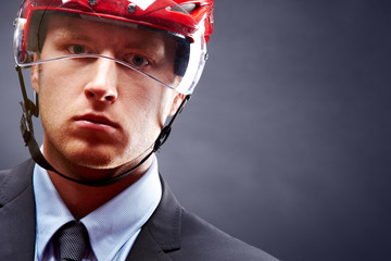Man in hockey helmet