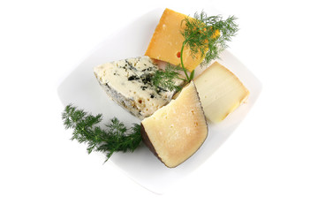 aged cheeses on white porcelain plate