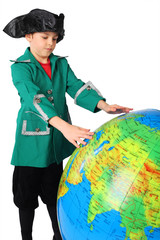 little boy in historical dress looking at big inflatable globe