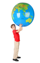 boy in red shirt holding big inflatable globe over his head