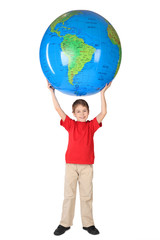 boy in red shirt smiling and holding big inflatable globe