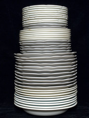 Plates in a stack on a black background.