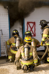 fire fighters prepare to enter burning building
