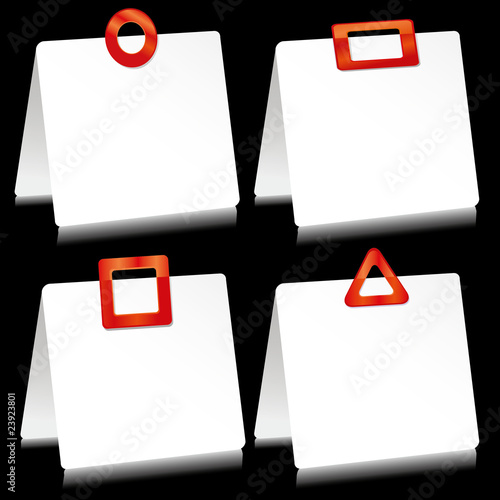 Set of sheets of paper as note pads with  red clips