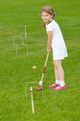 Little girl playing crouqet