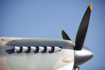 Vintage  propeller, V12 engine and exhaust pipe.