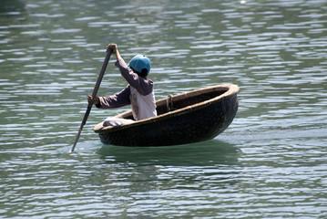 Vietnamese fisherman and his boat