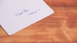 "Time lapse of letter with love message ""I love You"""