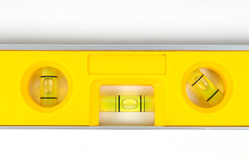 Yellow spirit level isolated on a white background