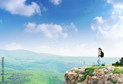 Girl on the peak of mountain