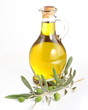 Branch with olives and a bottles of olive oil