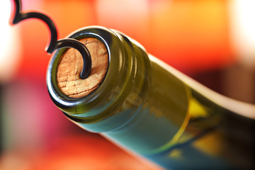 Cork screw and wine bottle