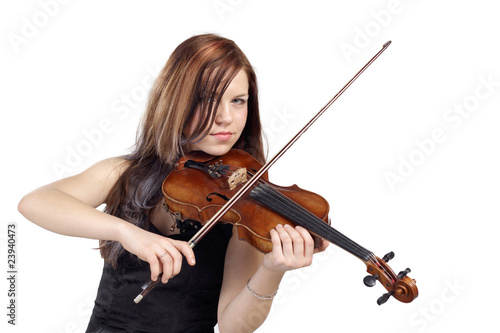 Young woman play the violin isolated in white background