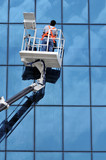 Window washer on a highrise office building in downtown