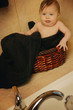 Baby Sitting In Bathroom Basket