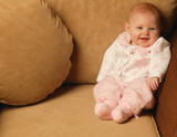Baby Girl Smiles In Chair