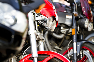 Motorbike's chromed engine. Bikes in a street