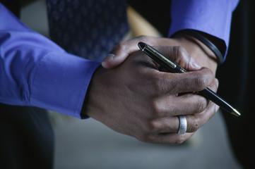 A Businessman Holds A Pen