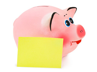 Piggy bank and note paper