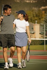 Couple In Tennis Courts