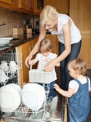Family put dishes in the dishwasher