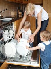 Family besides open dishwasher