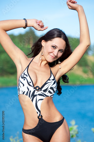 Girl with perfect body on the lake