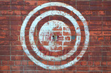 Fototapety Target on the red brick wall. Urban style.