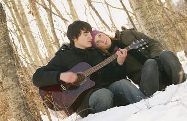 Couple enjoying the guitar together