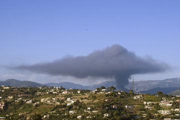 Dark cloud of pollution due to a factory on fire