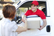 delivery courier delivering package and handshake
