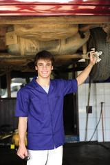 portrait of a car mechanic at work at the car  repair  shop