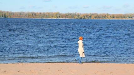 woman on sandy beach moves rotating