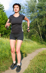 Woman jogging outdoors in forest
