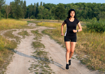 Woman jogging outdoors in summer