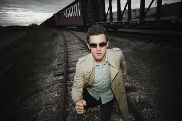 Man Runs Alongside A Train