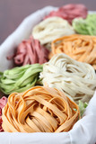 Tagliatelle pasta dyed with vegetables poster