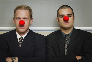 Businessmen Wearing As Red Nose Looking Serious