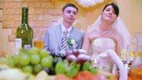 bridegroom and bride sits at wedding table