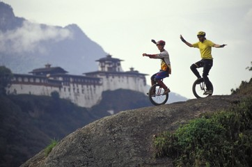 Unicyclists Riding Down Hill